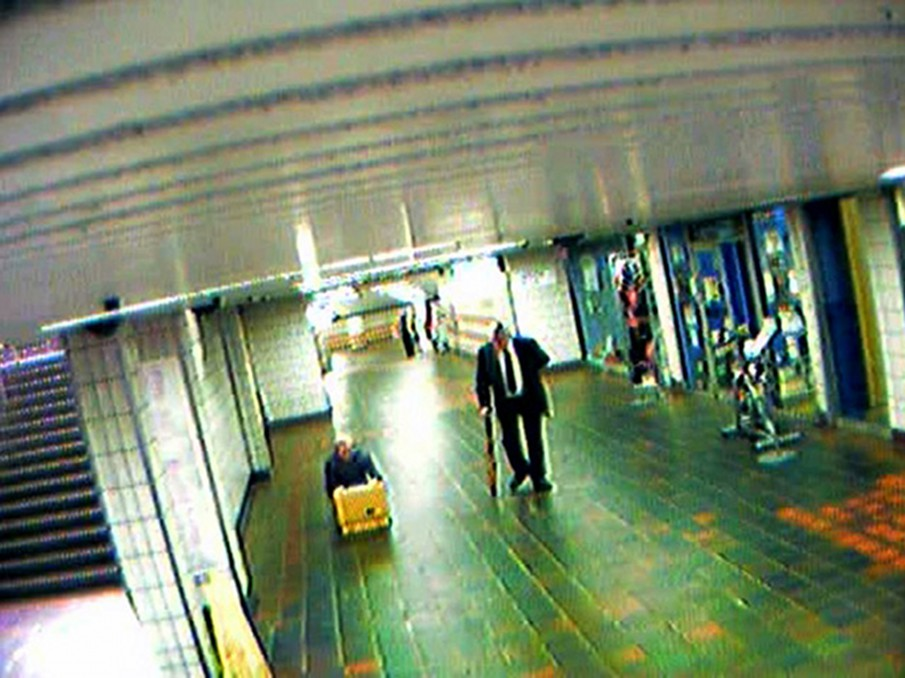 !Mediengruppe Bitnik - Still from Surveillance Chess showing Bitnik with yellow suitcase in Charing Cross subway station
